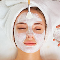 Photo of a woman getting a facial treatment